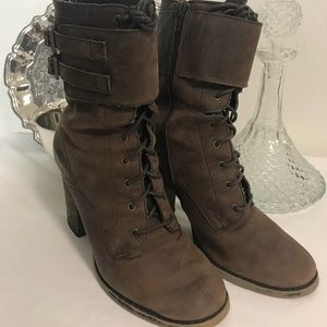 Brown suede industrial lace-up boots.